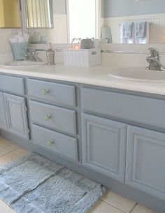 To give the bathroom a fresh and clean look, she repainted the cabinetry in the same light blue added new sea-glass green drawer pulls from Anthropologie
