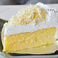 A layer of white chocolate cheesecake topped with a whipped cream cheese topping.