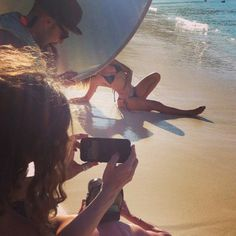 SI Swimsuit crew filming a beach shot