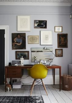 The neutral wall is a perfect backdrop for those great eclectic art pieces, and I love the pop of colour with the chair.