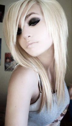 i like the layered cut and bangs...wonder if i could do this with longer hair