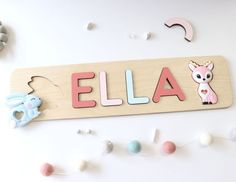 dWooden Name Puzzle with teething toys by WoodilyToys. Baby Girl Montessori Toy - First Birthday gift - Welcome baby - Woodily Toys // Rainbow & Unicorn. This puzzle includes two silicone teething toy shapes: rainbow and unicorn. Our Personalized custom name puzzles are designed to fuel imagination, inspire exploration and encourage the natural curiosity that leads to a lifetime of learning #busypuzzle #woodtoy Fun Games For Kids, Indoor Activities For Kids, Puzzles For Kids, Diy For Kids, Gifts For Kids, Wooden Toys For Toddlers, Toddler Toys, Baby Toys, Kids Toys