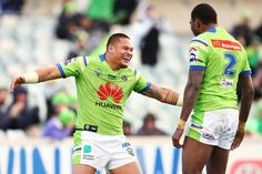Joseph Leilua of the Raiders celebrates with team mate Edrick Lee after scoring a try during the round 20 NRL match between the Canberra Raiders and the New Zealand Warriors at GIO Stadium on July 23, 2016 in Canberra, Australia.