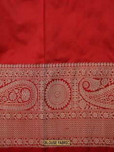 Elegant white silk saree with paisley brocade border and pallu in gold zari. Saree is embellished with beautiful floral zari booties. Contrast red blouse with paisley brocade border in gold zari adds to the elegance of saree. The fabric has a soft.