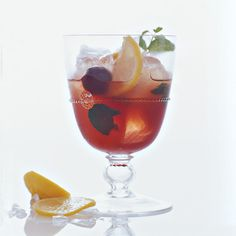 Kentucky Cousin INGREDIENTS 4 mint leaves, plus 1 mint sprig 3 lemon slices 4 brandied cherries 1/2 ounce Simple Syrup 1 cup ice 2 ounces bourbon 1/2 ounce Cherry Heering or cherry liqueur 1 ounce chilled brewed black tea 1/2 ounce fresh lemon juice
