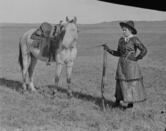 1900.  Sadie Austin, daughter of Charles Austin, a ranchman and old settler of Sargent, Nebraska. When her father was short of help, Sadie, now Mrs. Thompson, would put on a divided skirt and ride the range for her father.  From the collection of Solomon Butcher.
