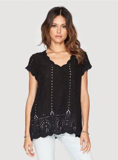 Britania Blouse The Johnny Was Daisy Britania Blouse is a boho take on your classic t-shirt. This blouse features delicate embroidery around the top and bottom hem and stunning eyelet detail on the bottom. Keep it simple by pairing this blouse with your favorite jeans and slip-on sneakers for a casual yet pulled-together look.  -100% Rayon -Relaxed Fit -Short Sleeves and V-Neck -The model is wearing a size Small. Measurements for a size Small: Shoulder: 15