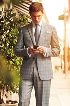 Shop this look for $154: http://lookastic.com/men/looks/blazer-and-pocket-square-and-tie-and-dress-shirt-and-dress-pants/830 — Grey Plaid Blazer — White Pocket Square — Charcoal Tie — White Dress Shirt — Grey Plaid Dress Pants