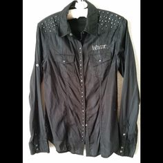 Harley-Davidson Black Shirt Button Up In excellent condition. Long sleeves, convertible roll-tab sleeves. Pyramid stud snap front, chest pockets and cuffs. Stud details on front yoke and front pocket. Flag label on center back neck. 100% cotton.   No trade. I do not respond ❤️Make an offer. Do not ask for lowest Harley Davidson Tops Button Down Shirts