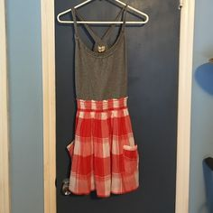 ☀️Adorable Hollister Summer Dress☀️ Super cute tank dress...gray cotton knit top and orange and white plaid bottom. Gathered middle. Great square side pockets. Perfect for an early dinner and a Saturday morning green market. ❤️❤️ Hollister Dresses Mini
