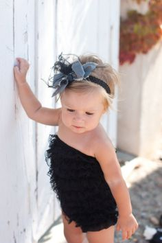 Black lace ruffle romper with grey silk bow by PrettyPetalsHair, $29.95  Can you tell I LOVE rompers!?!?!