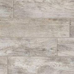 This gray wood look porcelain tile would look nice in the kitchen with the LG Black Stainless Steel Appliances.