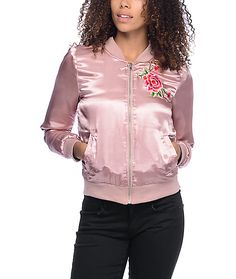 Bring some feminine flare into your wardrobe with the Floral Embroidery pink satin bomber jacket for girls from Almost Famous that has a luxuriously soft satin construction with lightweight fill and rose embroidery detailing at the left chest.