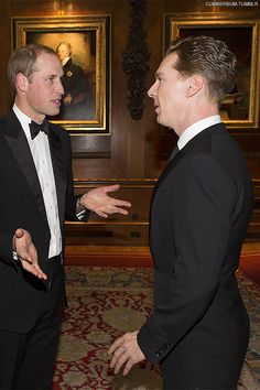 The Duke of Cambridge speaks with Benedict Cumberbatch at a dinner to celebrate the work of The Royal Marsden at Windsor Castle.