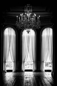 Grand windows. Beautiful chandelier.