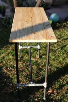 Pine top table with metal industrial pipe legs.