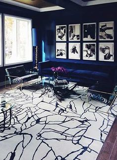 Rich blue, ceiling detail & black and white abstract rug
