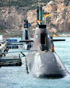 German submarine U33 and Portuguese NRP TRIDENTE during NATO exercise . NobleMariner.