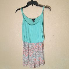 A romper that is great for the summer!!! Looks like a dress but has shorts a light blue with a chevron color on bottom. Rue 21 Other