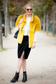 How to Wear an Envelope Midi Skirt - black envelope midi skirt worn with a white blouse + bold yellow short-sleeve fur coat and ankle boots.