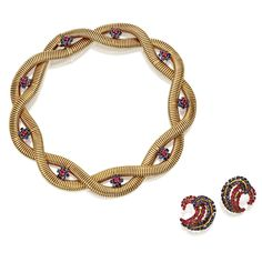 Gold, sapphire & ruby necklace & a pair of earclips, signed John Rubel Co. circa 1945 The necklace composed of flexible ribbed links set with round rubies and sapphires, length 15 inches; the earclips set round rubies, sapphires and diamonds. Estimate  15,000 — 20,000  USD