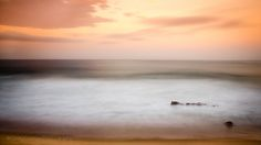 Incoherent Beauty - This is a minimalist long exposure shot of a restless ocean while an intense sunset gracefully unfolds over the horizon. This photo was taken in Kwazulu Natal, South Coast, South Africa on the 2nd of April 2014.  EXIF data (30 sec at f11, ISO 100) at 105mm
