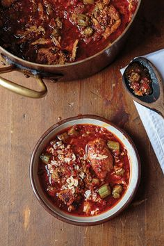 Creole Okra Gumbo | This gluten-free version of gumbo forgoes a roux in favor of using tomatoes and okra as a thickener. While adding tomatoes to gumbo is heresy in many Cajun kitchens, Creole cooks are fans of the bright, sweet complexity they add to the dish.