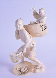 A 19TH CENTURY JAPANESE MEIJI PERIOD CARVED IVORY OKIMONO modelled as a male holding a child within a basket. 17 cm high.