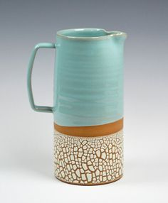 Stoneware pitcher available in three of our signature colors and crackle glaze exterior.  Robins egg blue Cream White Charcoal Grey  Great for iced tea, lemonade or sangria. Will hold over a gallon of liquid. Dimensions approximately 4.75Wx9H.   Serve drinks at your next get together with style or use to display fresh cut wild flowers in a beautiful centerpiece. These are made to order so please allow 2-3 weeks for shipping. Delivery could be sooner if we happen to have them in stock. Send a…