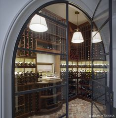 Steel doors add modernity to this sophisticated and elegant wine room by Harrison Design Open Space Living, Living Spaces, Indoor Climbing Wall, Steel Doors And Windows, Harrison Design, Shingle Style Homes, Iron Doors, Living Room Interior, Cottage Style