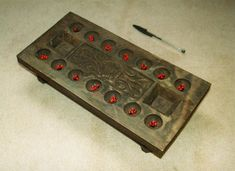 'Mancala may well be the oldest board game in the world since, like Morris variations, it can be easily played with whatever medium happens to be around. For instance, in Africa, people often play with pebbles using hollows scooped into the earth, with cowrie or other seashells in rings in the sand or specially carved wooden board with seeds. It is a wholly mathematical game - its more complex versions have as much scope as Chess, despite its primitive origins.