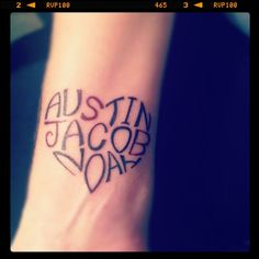 Kids names wrist tattoo design in a heart shape