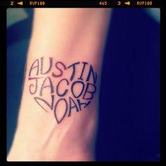 Kids names wrist tattoo design in a heart shape