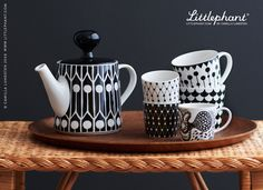 Littlephant Porcelain Teapot Feathers Black/White, Mugs Net, Aquatic, Waves and Berrystring. Designed by Camilla Lundsten, available at www.Littlephant.com (© Camilla Lundsten 2008).