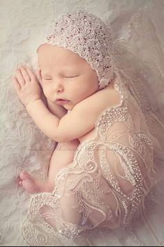 Gorgeous newborn photo.  Wedding dress and veil