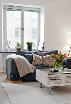 cozy living room - love the mix of modern/clean lines with rustic/worn.