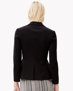 The peplum jacket. Fitted yet ideal for accentuating curves, this ultra-feminine jacket is made from a unique bi-stretch cotton nylon twill from Italy for a second-skin fit, polish and comfort. Dress it with a skinny pant or for an overtly directional look with super wide pants.