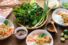 Vietnamese rice noodle bowls are festooned with lemongrass-scented shrimp, a sweet-and-spicy sauce and piles of fresh herbs. Vietnamese Rice, Vietnamese Recipes, Rice Noodle Recipes, Sweet And Spicy Sauce, Asian Recipes, Ethnic Recipes, Healthy Recipes
