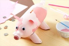 Make a piggy bank...or a puppy or kitty bank out of old water or soda bottles.