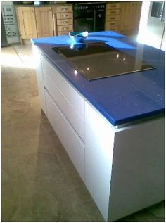 Inspirational This island is wonderfully designed with a very modern attractive blue mirror fleck engineered stone worktop