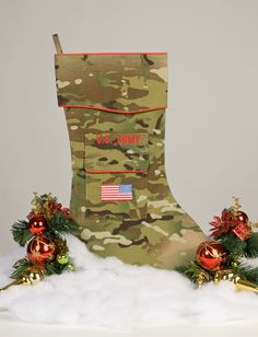 """The Army Christmas stocking is crafted in a new camouflage fabric. It's trimmed in scarlet piping and features the """"reverse American flag"""" embroidered on the stockings pocket. This new Army uniform fa Christmas Baby, Christmas Greetings, Christmas Crafts, Christmas Ideas, Christmas Stuff, Christmas Tree, Patriotic Decorations, Christmas Decorations, Holiday Decor"""