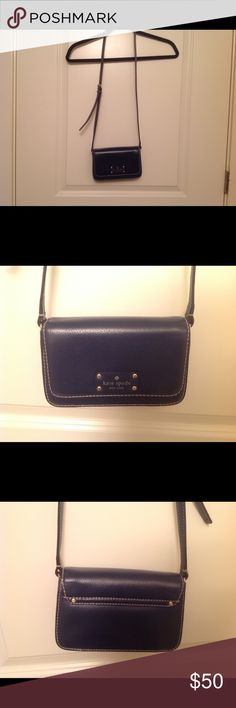 Kate Spade navy blue mini cross body bag Cute and stylish! It is a mini cross body bag. Big enough to put one apple 7 plus phone, a card holder and two keys. Cannot hold anything more. Please make sure it is the right size you want before you buy. kate spade Bags Crossbody Bags