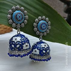 Oxidised silver tone blue jhumka with hand painted Meenakari work 💙 . Indian Jewelry Earrings, Indian Jewelry Sets, Fancy Jewellery, Silver Jewellery Indian, Jewelry Design Earrings, Ear Jewelry, Antique Earrings, Stylish Jewelry, Bridal Jewelry