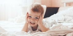 2 years old little boy dressed in pajamas are relaxing and playing in the parents bed, warm and cozy scene. Best Mother, Little Rock, Warm And Cozy, Parents, Relax, Stock Photos, Teaching, Mom, Kids