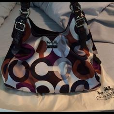 Authentic Coach purse Cute coach purse in great condition. Has 3 different sections. Has plenty of room for what you want to carry! Coach Bags