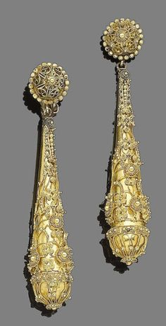 A pair of pendant earrings, circa 1870 Each elongated drop overlaid with corded wire and fine granulation detail, to a similarly-set domed surmount, composite, one later clip, one clip deficient, length 7.4cm