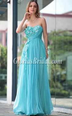 Blue strapless floor length evening dress.