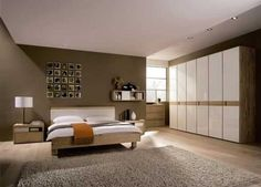 Large Modern Bedroom Cupboards with brown wooden bed frames brown white wooden headboard white covered bedding sheets white pillows