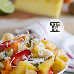 Tropical Fruit Salad Recipe Lunch and Snacks, Desserts, Salads with pineapple, strawberries, mandarin oranges, kiwi, bananas, honey, lime juice, cinnamon, sweetened coconut flakes
