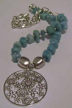 Baby blue dyed jade nuggets with an upcycled silver plated chain showcase an Austrian Swarovski Crystal pendant.  SOLD